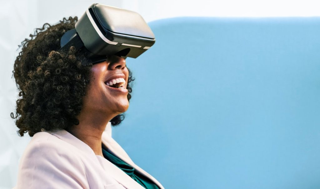 Woman with VR headset laughing